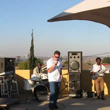 Richard doing a bit of crooning at The Rock rooftop venue in Soweto